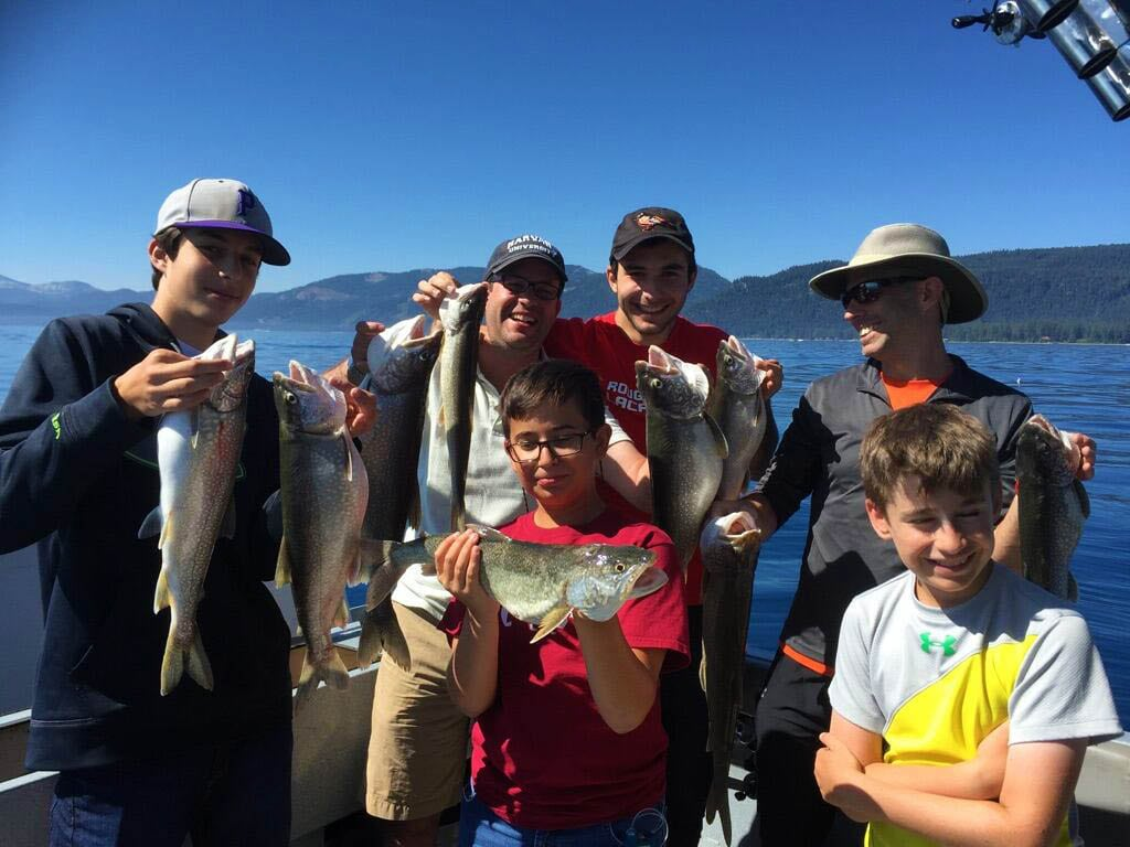 Family fishing a private charter with Mile High Fishing