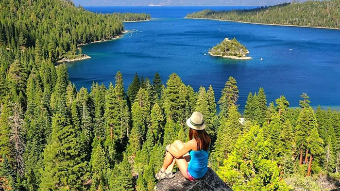 Girl hiking and viewing Lake Tahoe landscape