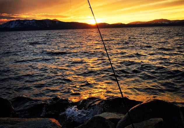 Lake Tahoe shoreline fishing during sunset